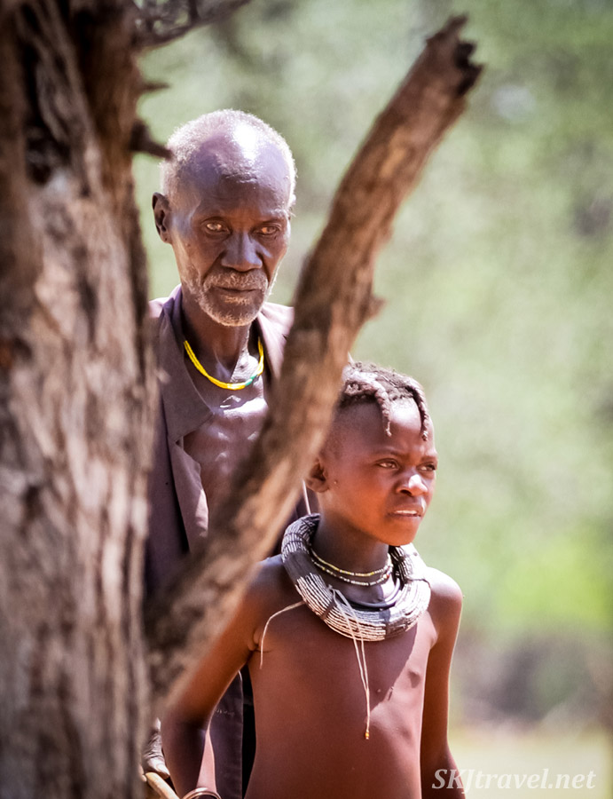 Blind Himba man and Himba girl. Kunene region of Kaokoland, Namibia.