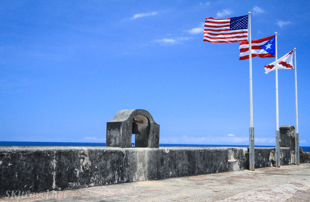 Three flags flying at Castillo San Cristobal, Old San Juan, Puerto Rico. The Spanish military flag, Puerto Rico's flag, USA flag.