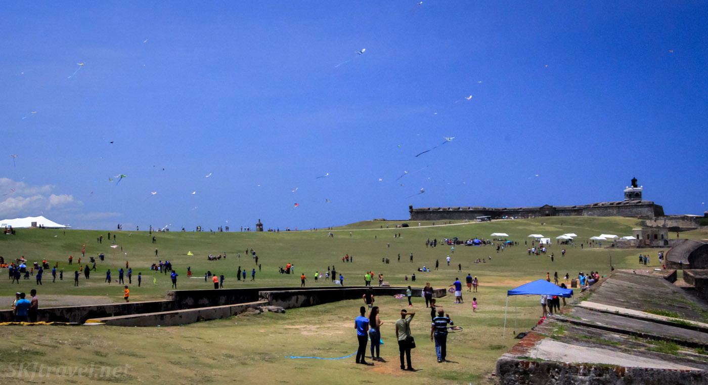 Many locals flying kites on the extensive lawn outside Castillo San Felipe del Morro, Old San Juan, Puerto Rico.