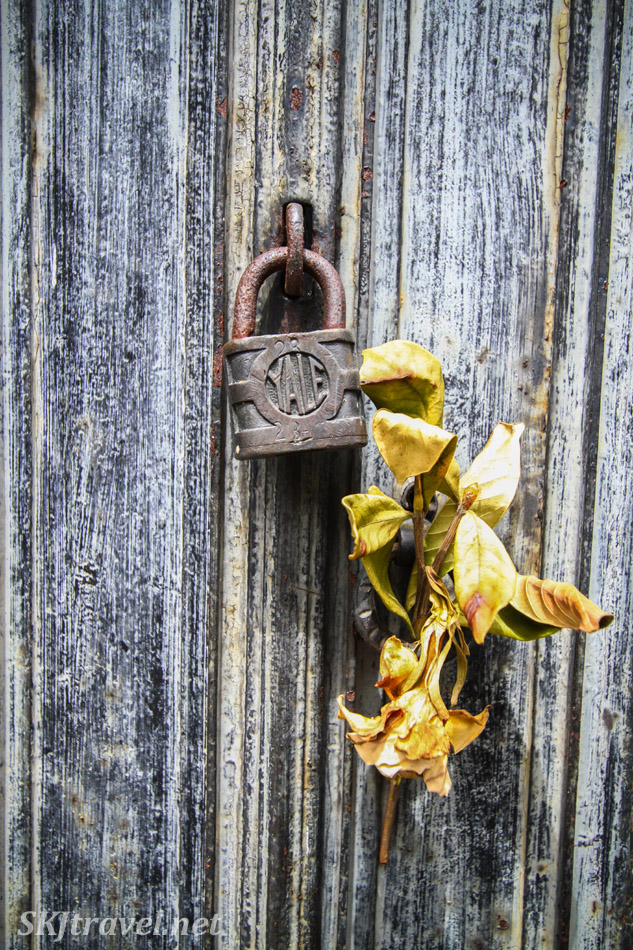 Padlock and dried flowers on a door to a mausoleum in Recoleta Cemetery, Buenos Aires, Argentina.