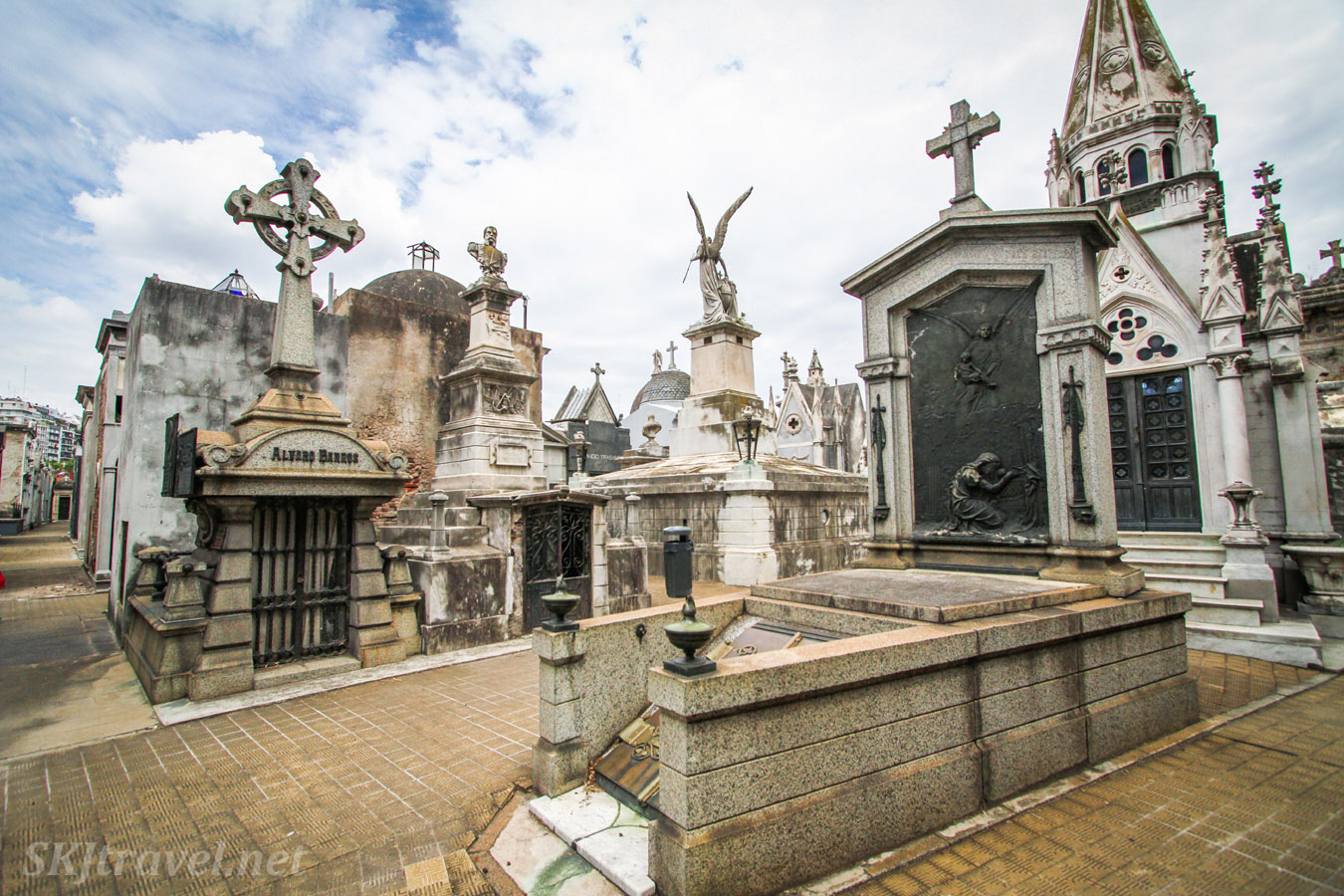 A street in Recoleta Cemetery, Buenos Aires, Argentina, showing the skyline stone statues and crosses.