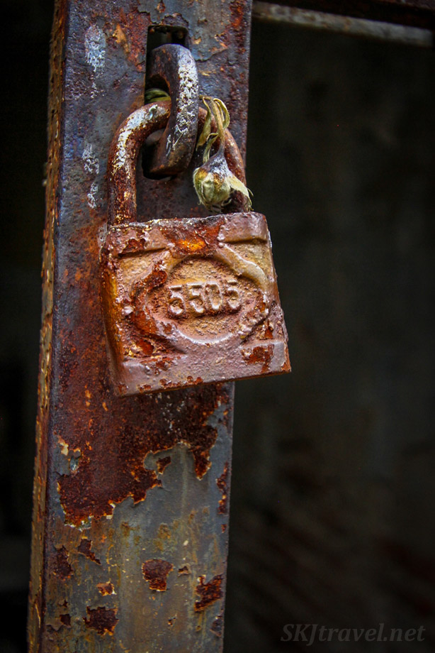 Rusted padlock holding closed doors to a mausoleum inside Recoleta Cemetery, Buenos Aires, Argentina.