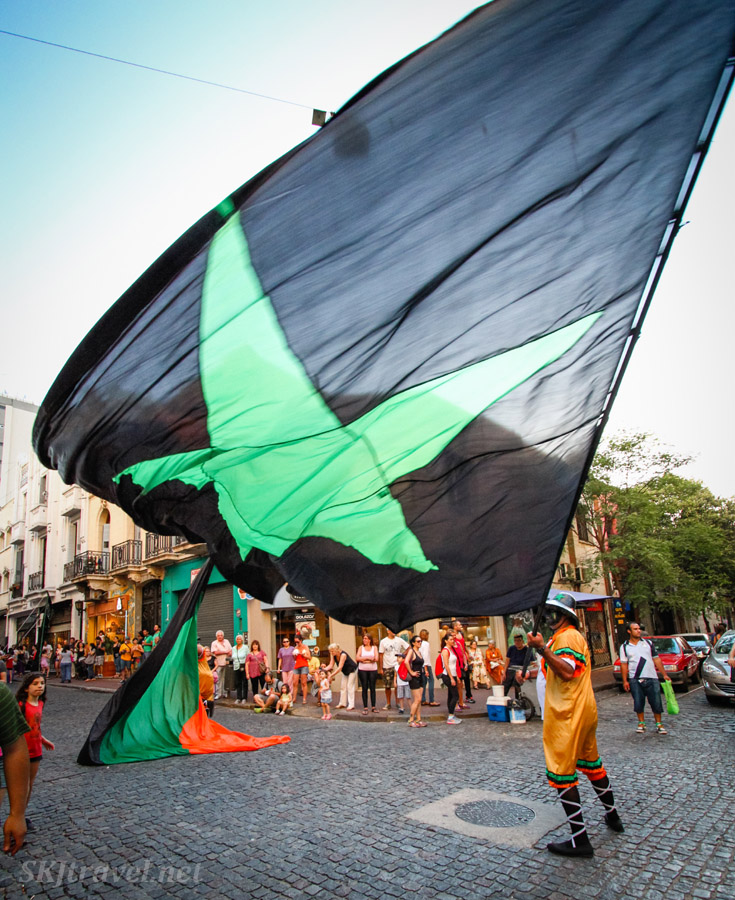 Comparsa flag, black with green star, in the San Telmo Candombe parade, Buenos Aires, Argentina.