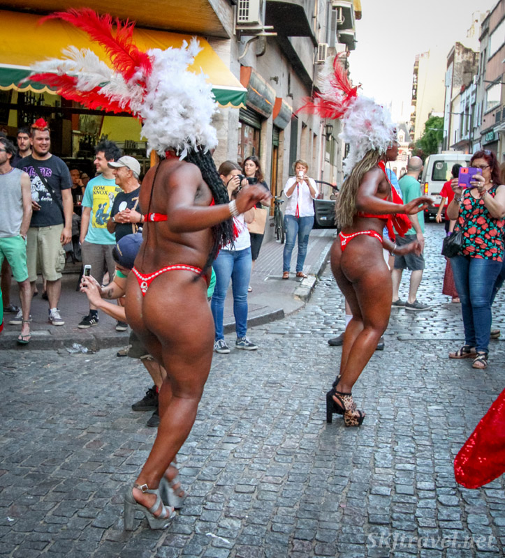 Very skimpily dressed women, Carnaval style, dancing in the San Telmo Candombe parade, Buenos Aires, Argentina.