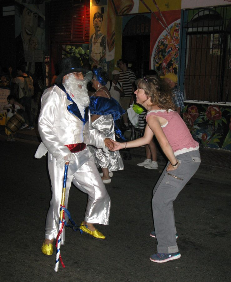 Me dancing with a Gramillero character at the end of the night in the San Telmo Candombe parade, Buenos Aires, Argentina.