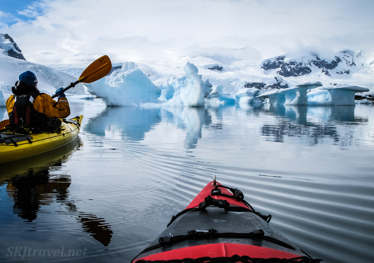 Kayaking through icebergs at Cuverville Island, Antarctica.