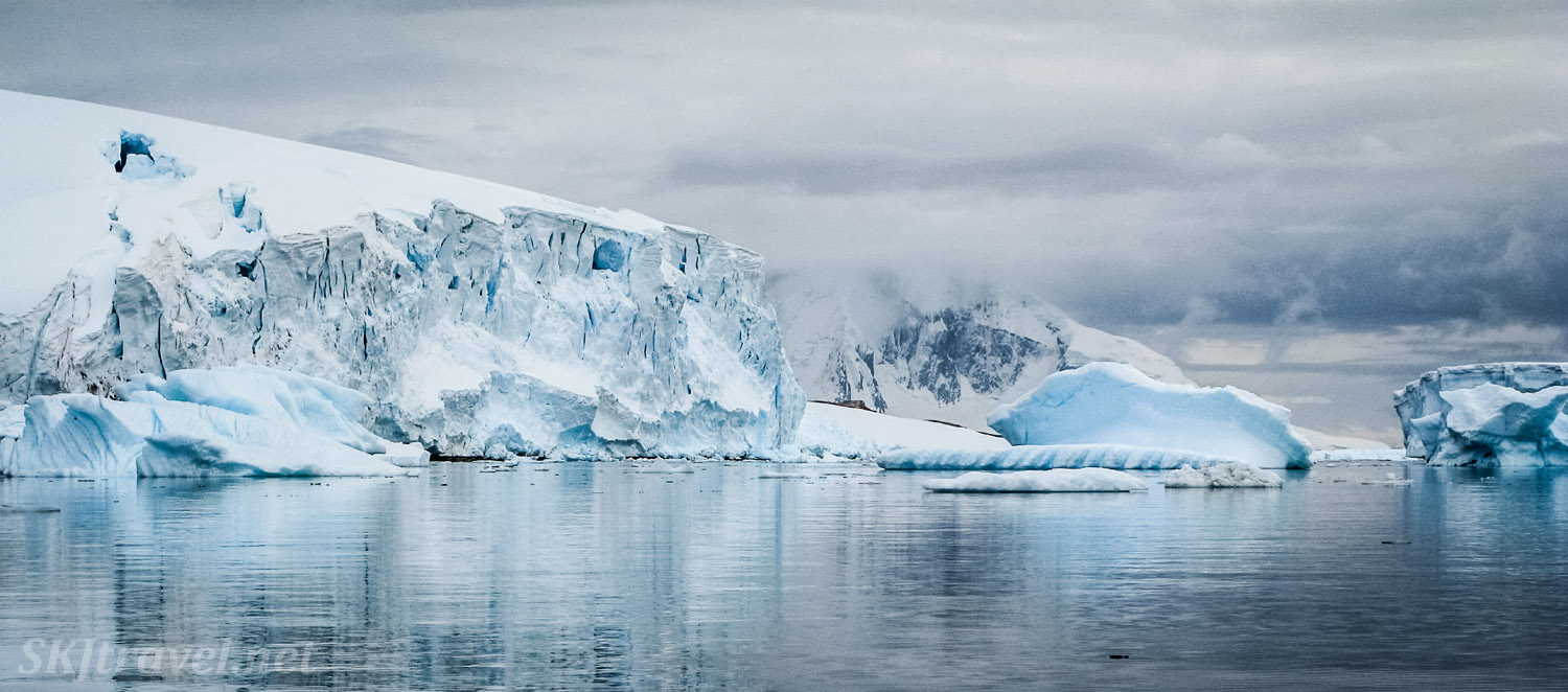 Kayaking among glaciers and huge icebergs at Cuverville Island, Antarctica.