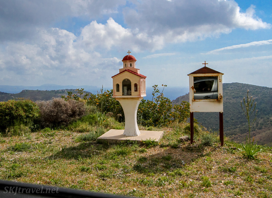 Two roadside memorial shrines side by side in the mountains of Chios Island, Greece.