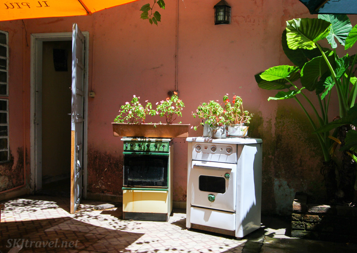 Tea cafe patio with old kitchen appliances turned into planters, Colonia del Sacramento, Uruguay.