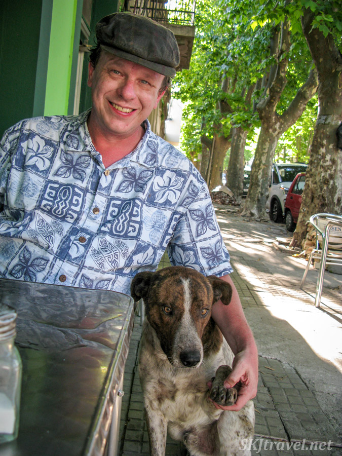 Erik makes friends with a dog, Colonia del Sacramento, Uruguay.
