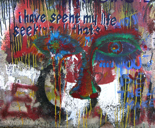 Graffiti on the John Lennon wall in Prague. Colorful weeping eyes.