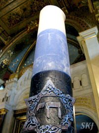 Blue and white candle inside synagogue in Krakow Poland.