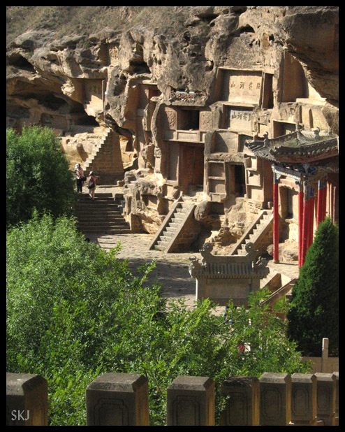 Caves and calligraphy carved into the cliff at Hong Xi Xia, Shaanxi Province, China.