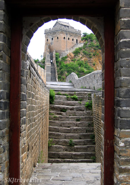 Looking through a doorway of one watch tower at another, this one kept up in better condition along the Great Wall. China.