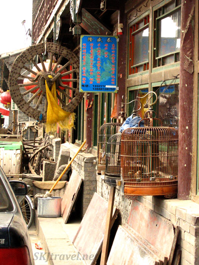 bird cages for sale outside a shop