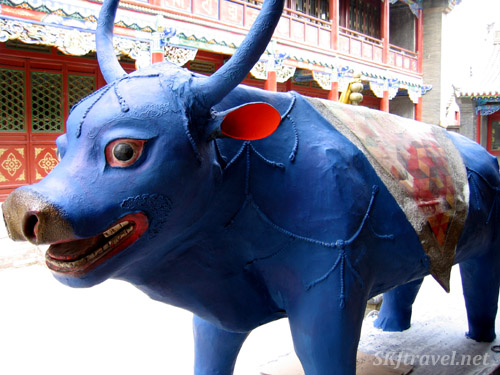 blue painted wooden bull