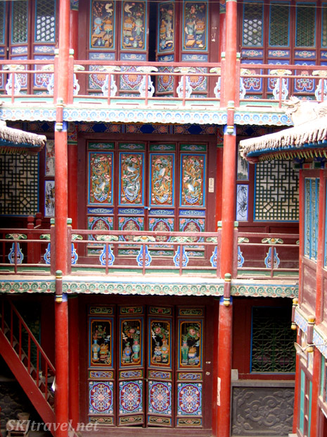 Several stories of brightly painted doors, Gao Miao, Zhongwei, China.