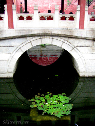 Bridge over a small water canal in the Inner Courtyard of the Forbidden City. Beijing.