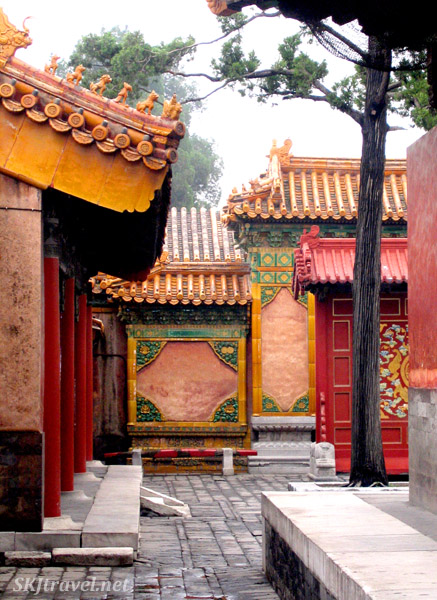 Screens and tile work in one of the courtyards inside the Inner Courtyard of the Forbidden City. Beijing.