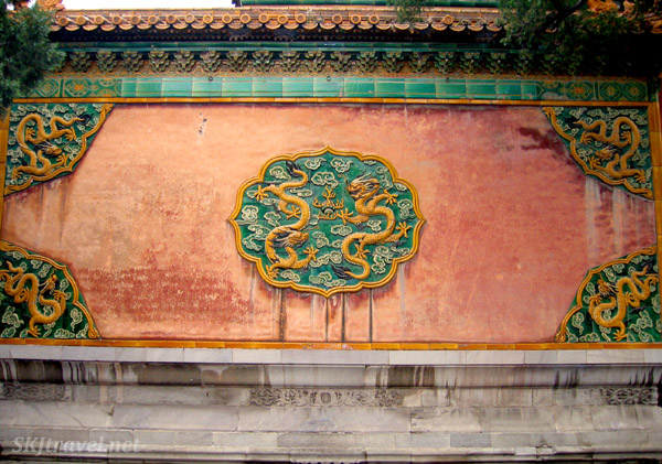 A spirit wall at the entrance to a small courtyard inside the Inner Courtyard in the Forbidden City, Beijing. It was believed spirits can only travel in a straight line, so a screen in the middle of an entryway would prevent them from reaching the buildings inside.