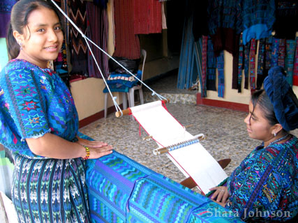 women at a small loom