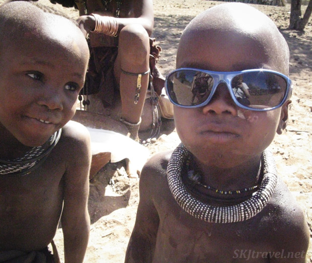 Little traditional Himba kid trying on my sunglasses. Kaokoland, Namibia.