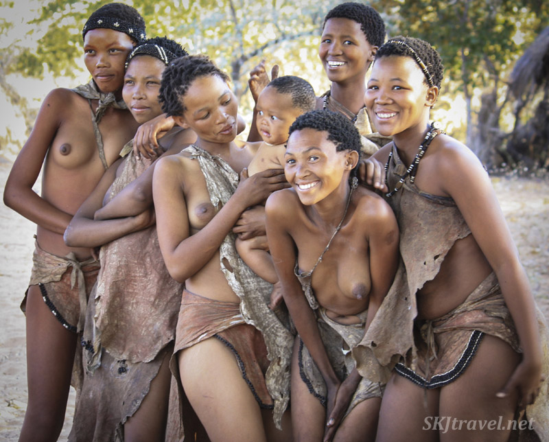 Young San women smiling for the camera. Namibia.