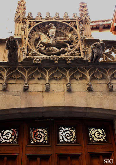 A door with stonce scultpure above it in Barcelona Spain. photo by Shara Johnson