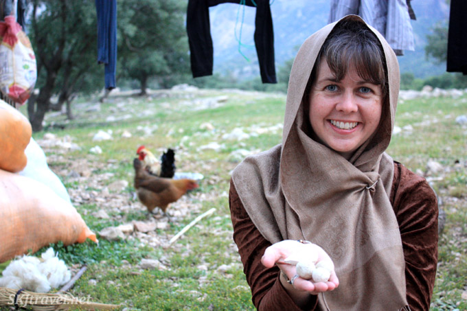 Holding sheep yogurt balls in my hand, made by the Qashqai nomads.