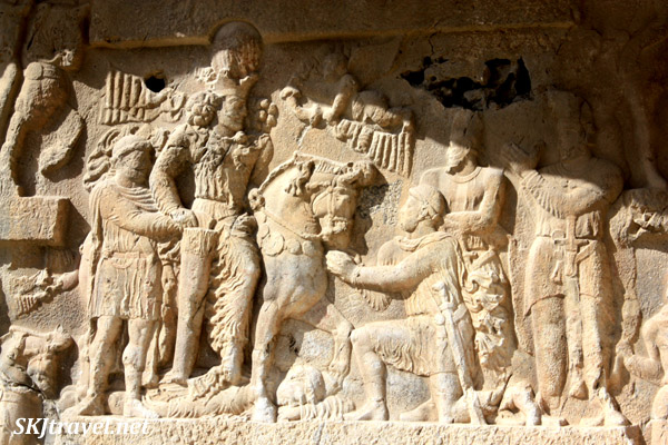 Stone relief depicting Persian victory over Romans, Bishapour. Iran.