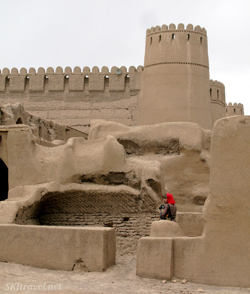 Red-scarved Shara among the ruins of Rayen, Iran.
