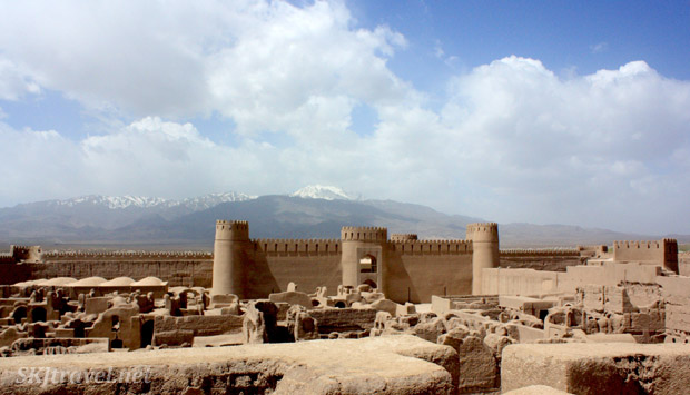 Looking over the walled citadel of Rayen, mountains looming behind. Iran.