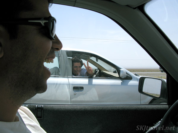 Men enthralled with my bare head on the highway.