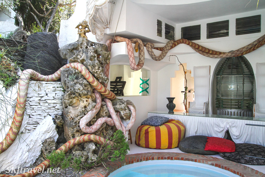 Comfortable sitting nook among fabric snakes in the courtyard of Dali's house in Portlligat, Spain.