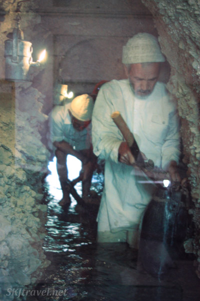 Photo of men working inside a qanat, Yazd, Iran.
