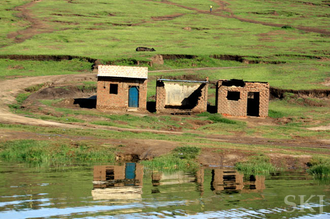 Dilapidate buildings along the shore of the Kazinga Channel, Queen Elizabeth National Park, Uganda.