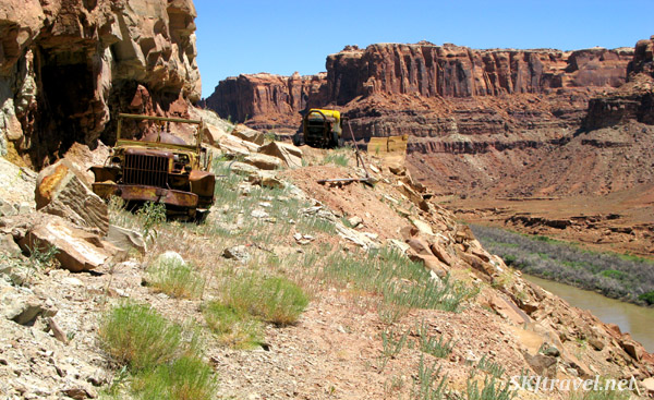 Two very old trucks used in mining operations at an abandoned uranium mine along the Green River, Utah.