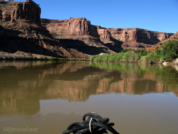 Reflection of rocks and shoreline on the Green River, Utah. As seen from the bow of our canoe.
