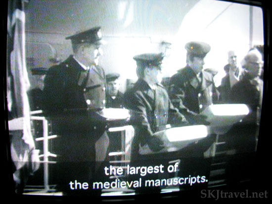 video footage still shot of official receiving large manuscript