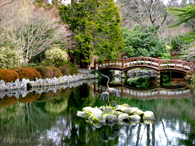 Bridge over a pond inside Hatley Gardens in early spring (late March). Vancouver Island, British Columbia, Canada.