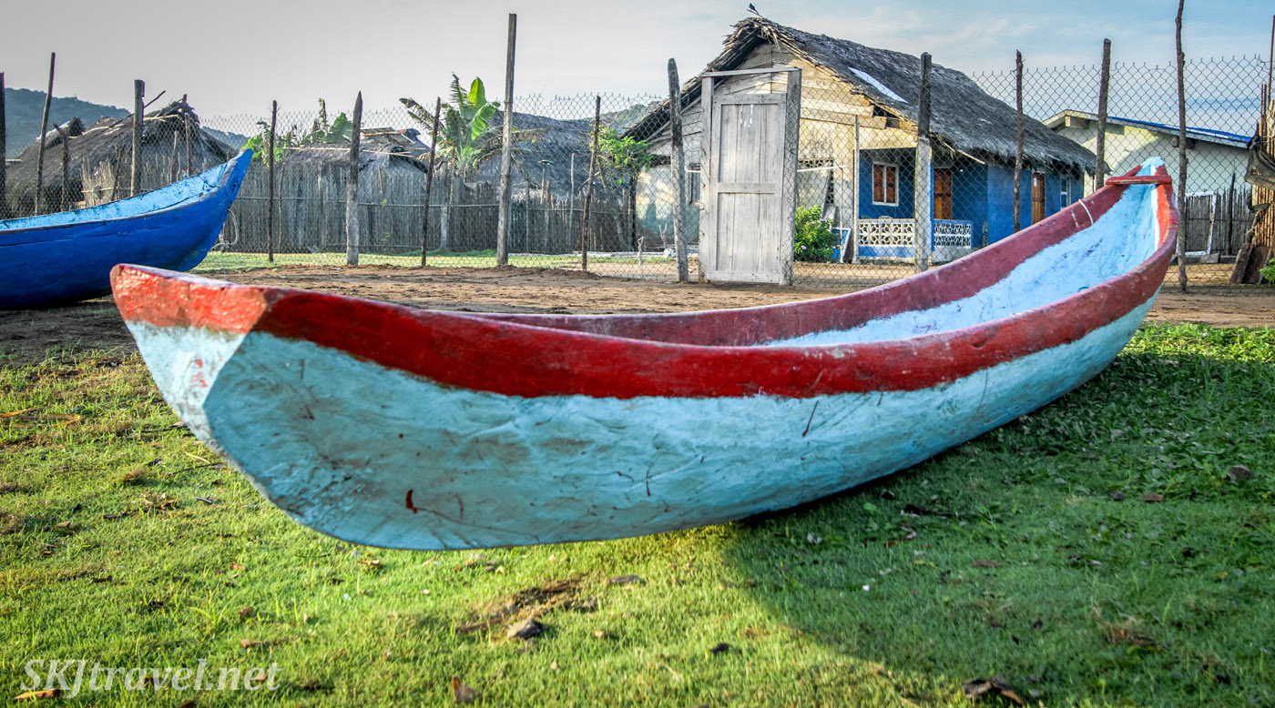 Dugout canoe beached in front of a home in Armila, Guna Yala, Panama.