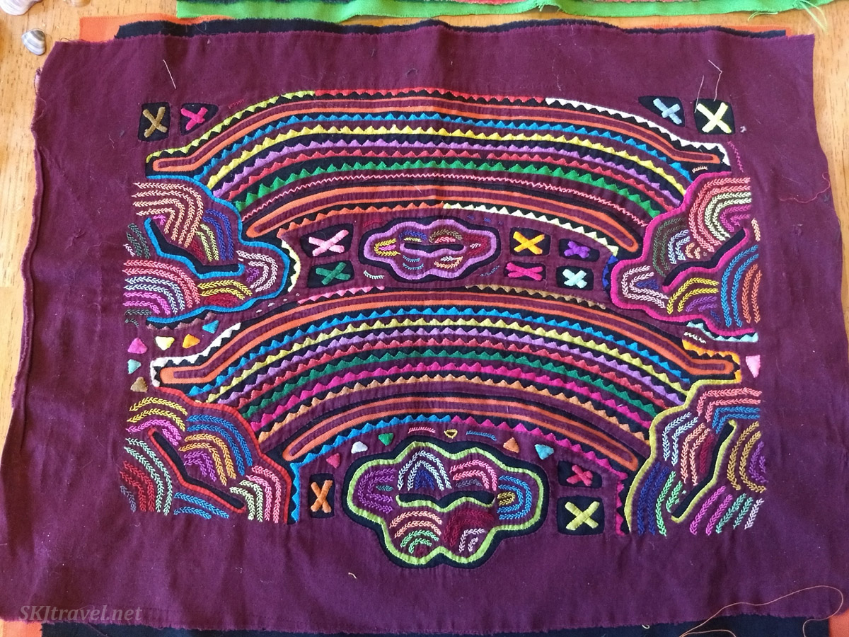 Rainbow design, traditional mola of Guna Yala people (Kuna), Panama.