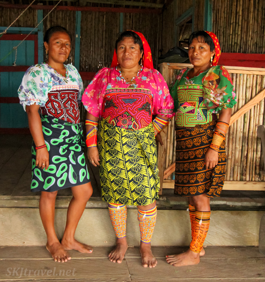 Three ethnic Guna (Kuna) women wearing traditional molas and winnis. Armila, Guna Yala province, Panama.