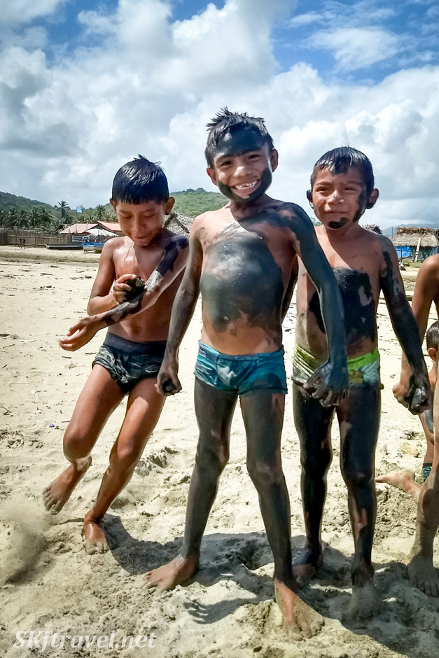 Indigenous children playing on the beach in Guna Yala village of Armila. May 2019