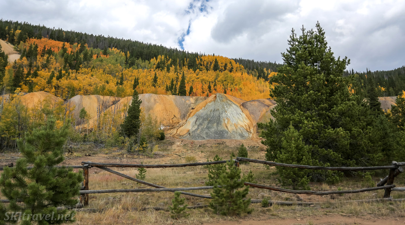 Golden aspen leaves, colorful tailings, autumn Breckenridge, Summit County, Colorado.