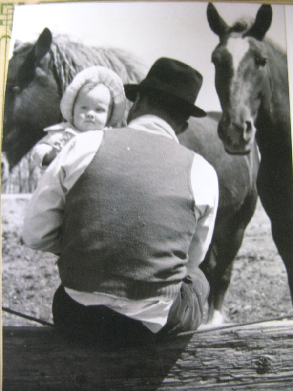 My grandpa and my infant mom with the horses, 1936. Cozad, Nebraska.