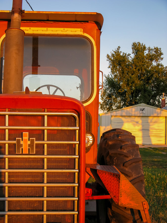Old Farmall tractor in front of my grandparents' garage. Clarence and Beulah Maack farm, Cozad, Nebraska.