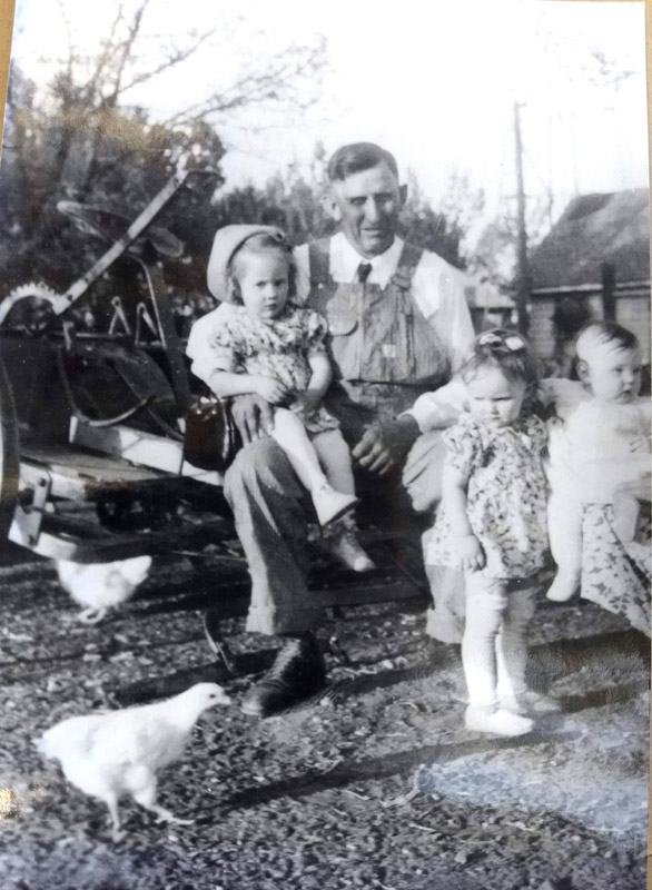 Frank Maack, my mom's grandpa holding her on his lap. 1930s, Cozad, Nebraska.