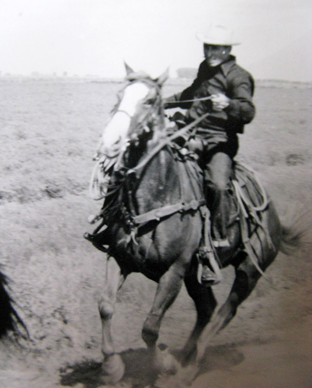 Clarence Maack riding a horse in a recreation of the Pony Express mail route. Cozad, Nebraska.