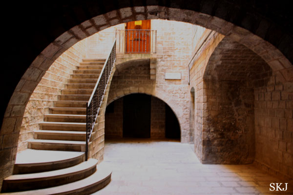 Small stone courtyard framed in an arch, early Roman ruins in Barcelona. photo by Shara Johnson